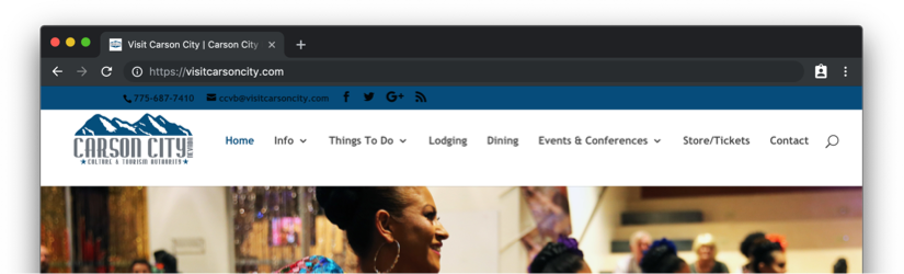 A screenshot of the Visit Carson City site header that has a horizontal row of links, with Events and Conferences being one of them. The navigation sits between a blue bar that has social media links and a large image that rotates with other images.
